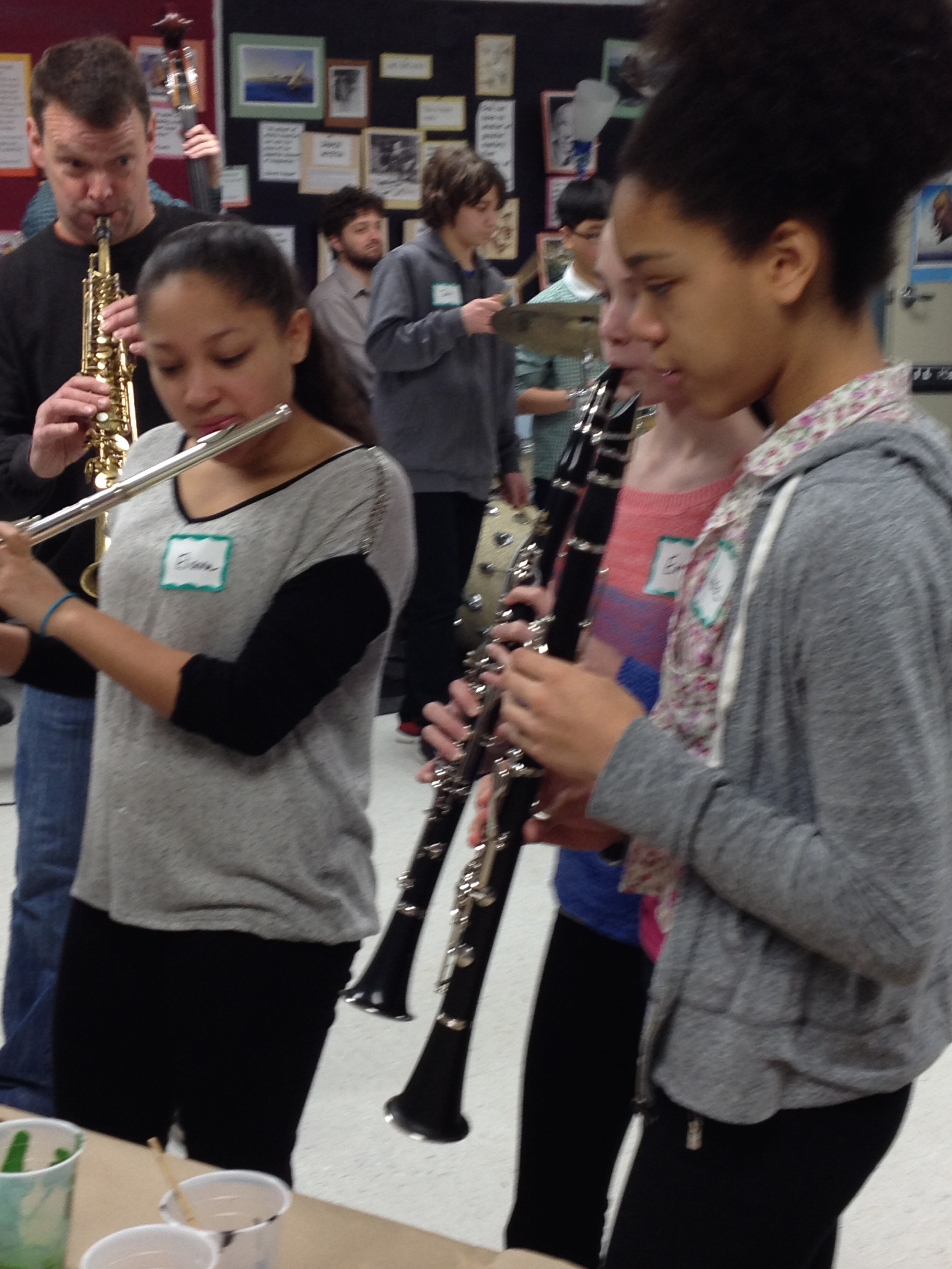 Woodwinds jam with the visual jazz painters as Matt Langley leads on his Soprano Saxophone in the background