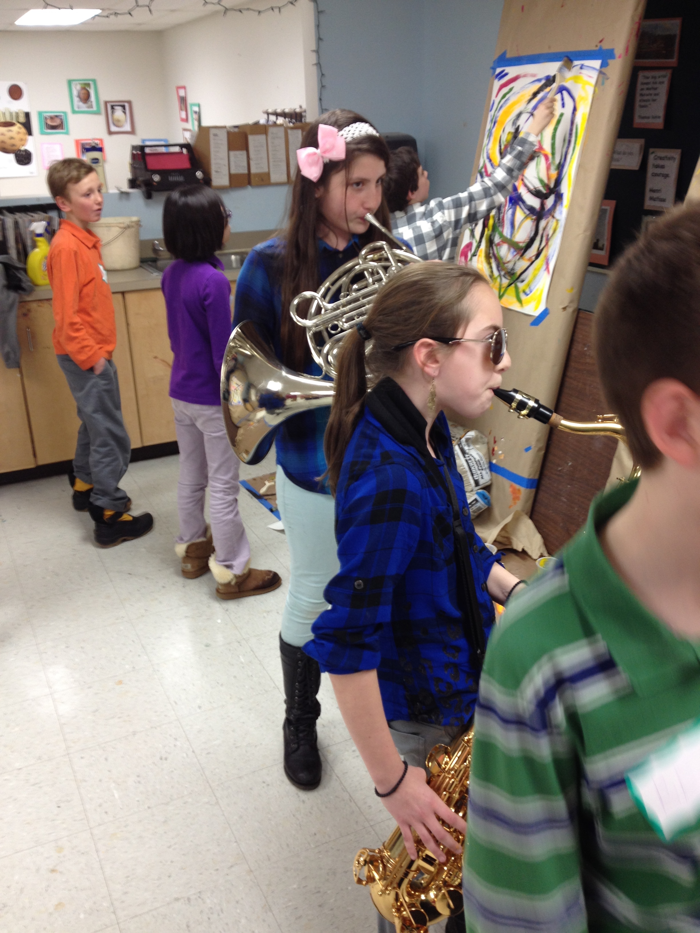 Six grade jazz students wade right into the visual jazz conversation, approaching each painter with call and response