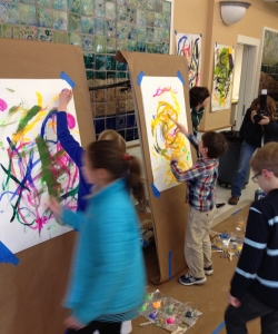 Young painters put their talents to work at the Harlem Renaissance Block party celebration. Amanda, seen in the background captures the event on film.